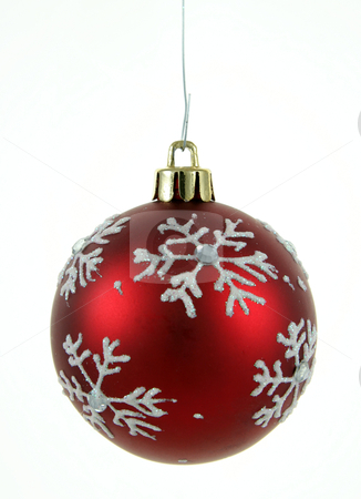 Red Snowflake Bauble stock photo, A single isolated red snowflake Christmas bauble hanging.  by Chris Hill