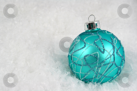 Aqua Christmas Bauble in Snow stock photo, An aqua Christmas bauble sitting in a bed of snow.  by Chris Hill