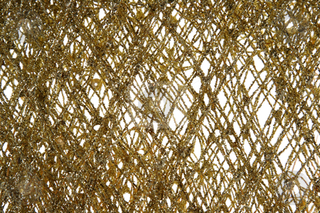 Gold Glitter Background stock photo, A close up of a gold glitter decoration.  by Chris Hill