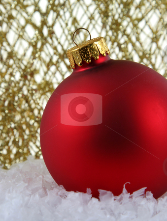 Red Bauble Backed by Gold Glittery Strings stock photo, A red Christmas bauble backed by gold glittery strings. by Chris Hill
