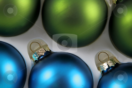 Blue and Green Xmas Baubles stock photo, A package of green and blue Christmas baubles. by Chris Hill