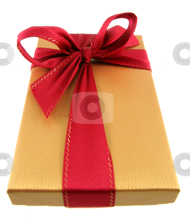 Golden Christmas Gift stock photo, A Christmas present wrapped in gold paper with red ribbon.  by Chris Hill