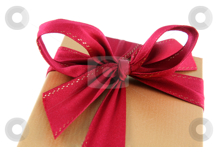 Red Bow Xmas Gift stock photo, A Christmas present wrapped in gold paper with red ribbon.  by Chris Hill