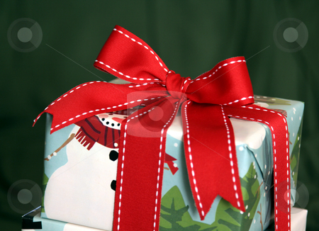 Christmas Present Wrapped with Red Ribbon stock photo, A large Christmas present wrapped with a red ribbon. by Chris Hill