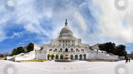 US Capitol - Government building stock photo, Wide angle panorama of the back of US United States Capitol building where inaugurations of presidents take place for Democrat Republican Government Senate and House parties under a summer blue sky with white clouds. by Paul Hakimata