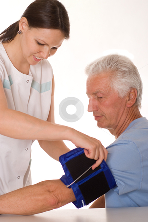Young woman doctor  stock photo, young woman doctor it measures the pressure by Alevtina Guzova