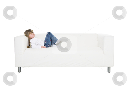 Young girl in a sofa stock photo, Young girl in a sofa isolated on white background by Anne-Louise Quarfoth