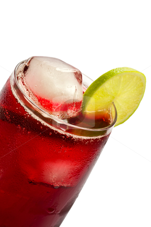 Hibiscus Iced Tea stock photo, Close-up of a glass of iced hibiscus tea with slices of lime on white background. by Glenn Price