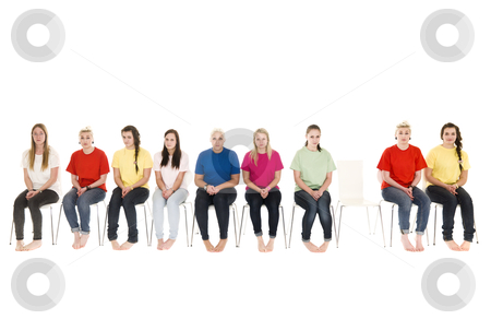Women on chairs stock photo, Group of women sitting on chairs and one empty chair by Anne-Louise Quarfoth