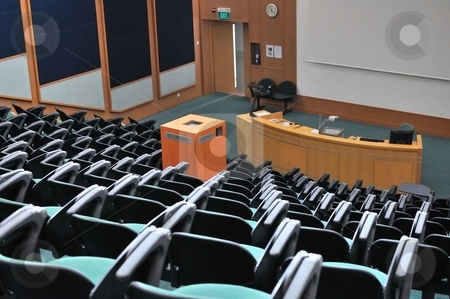 Lecture theater stock photo, Lecture theater showing white screen. For concepts such as school and education, business and training, and meetings and conferences. by Wai Chung Tang