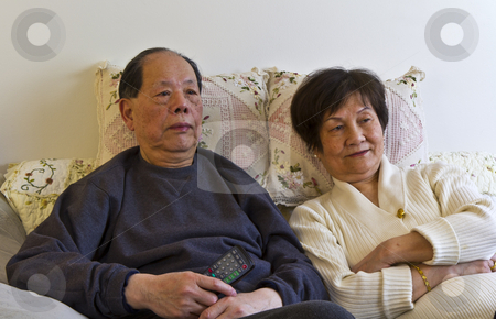 Senior couple watching Television stock photo, Senior couple watching their favorite television show by tab62