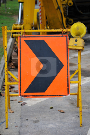 Righ arrow during construction stock photo, Right arrow during road works and construction. For industrial, construction and building concepts. by Wai Chung Tang