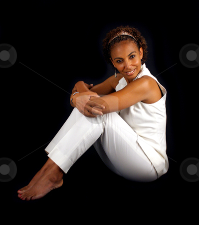 Beautiful Mature Black Woman Sitting (4) stock photo, A lovely mature black woman sits on a black background profile to the camera, allowing you to easily insert something for her to sit on or extract her from the black background to have her sitting on something. by Carl Stewart