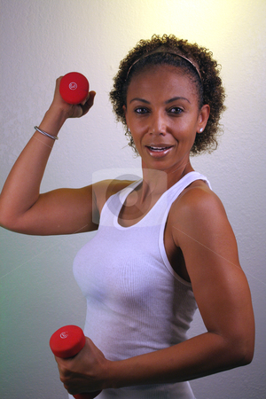 Beautiful Mature Black Woman Workout (1) stock photo, A lovely mature black woman works out with a pair of hand weights. by Carl Stewart