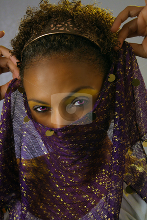 Beautiful Mature Black Woman Headshot (5) stock photo, Studio close-up of a lovely mature black woman holding a scarf or veil over her face, revealing her powerful and mysterious eyes. by Carl Stewart