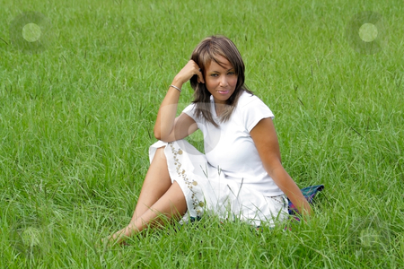 Woman in a Grassy Field (4) stock photo, A lovely mature black woman in a grassy field, looking into the camera with a relaxed, pleasant facial expression. by Carl Stewart