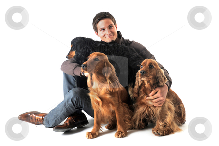 English cockers and man stock photo, portrait of a  purebred english cockers and man in a studio by Bonzami Emmanuelle