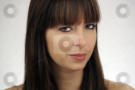 Beautiful Brunette Headshot (3) stock photo, A close-up of a lovely young brunette with a neutral facial expression. by Carl Stewart