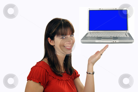 Beautiful Brunette Hostess (6) stock photo, A lovely young brunette hostess with a captivating smile, looks directly at the viewer while pointing to a laptop computer which displays a blank blue screen. by Carl Stewart