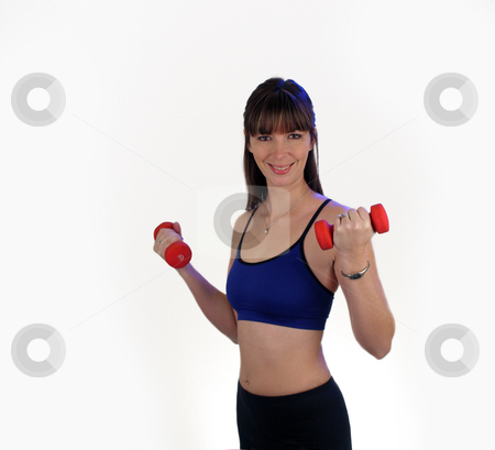 Beautiful Brunette with Hand Weights (1) stock photo, A lovely young brunette wearing fitness wardrobe, holds a pair of hand weights. by Carl Stewart