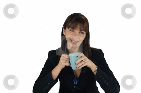 Beautiful Brunette Businesswoman with Coffee (1) stock photo, A lovely young brunette businesswoman looks directly at the viewer with a captivating smile, holding a cup of coffee or tea. by Carl Stewart