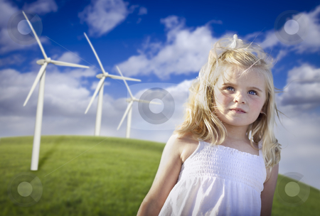 Beautiful Young Girl and Wind Turbine Field stock photo, Beautiful Young Blue Eyed Girl Playing Near Wind Turbines and Grass Field. by Andy Dean