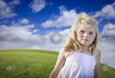 Adorable Blue Eyed Girl Playing Outside stock photo, Adorable Blue Eyed Girl Playing Outside in the Grass Field. by Andy Dean