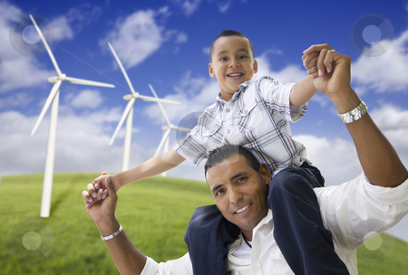Happy Hispanic Father and Son with Wind Turbine stock photo, Happy Hispanic Father and Son with Wind Turbine Farm Over Blue Sky. by Andy Dean