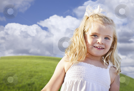 Adorable Blue Eyed Girl Playing Outside stock photo, Adorable Blue Eyed Girl Playing Outside in the Grass. by Andy Dean