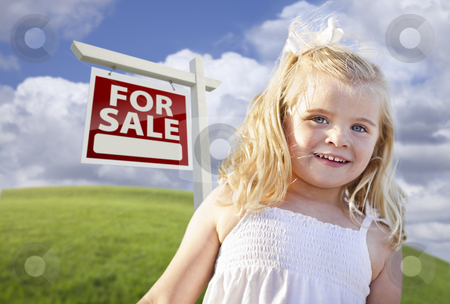 Smiling Cute Girl in Field with For Sale Real Estate Sign stock photo, Adorable Smiling Girl in Grass Field with For Sale Real Estate Sign Behind Her. by Andy Dean