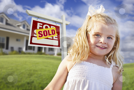 Cute Girl in Yard with Sold For Sale Real Estate Sign and House stock photo, Cute Smiling Girl in Front Yard with Sold For Sale Real Estate Sign and House. by Andy Dean
