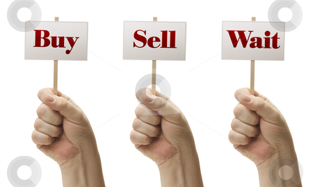 Three Signs In Fists Saying Buy, Sell and Wait stock photo, Three Signs In Male Fists Saying Buy, Sell and Wait Isolated on a White Background. by Andy Dean
