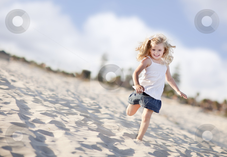 Adorable Little Girl Having Fun at the Beach stock photo, Adorable Little Girl Having Fun at the Beach One Sunny Afternoon. by Andy Dean