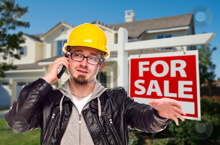 Contractor in Hard Hat in Front of House and Sign stock photo, Contractor in Hard Hat in Front of House and For Sale Real Estate Sign. by Andy Dean