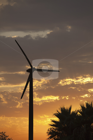 Silhouetted Wind Turbine Over Dramatic Sunset Sky stock photo, Silhouetted Wind Turbine Over Dramatic Sunset Sky and Clouds. by Andy Dean