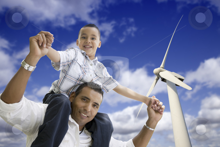 Happy Hispanic Father and Son with Wind Turbine stock photo, Happy Hispanic Father and Son with Wind Turbine Over Blue Sky. by Andy Dean