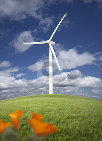 Wind Turbine Against Dramatic Sky and California Poppies   stock photo, Wind Turbine Against Dramatic Sky, Clouds and California Poppies in the Foreground.  by Andy Dean