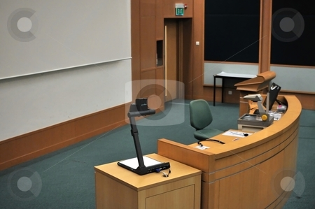 Speaker&amp;#039;s stand  stock photo, Speaker&#039;s stand in lecture hall. For concepts such as school and education, business and training, and meetings and conferences. by Wai Chung Tang