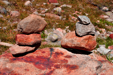Stones stacked  stock photo, stones stacked with mountain background by freeteo