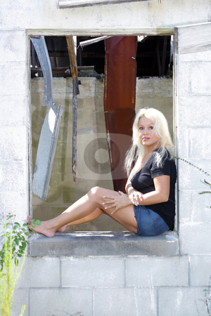 Beautiful Blonde at an Abandoned House (4) stock photo, A lovely young platinum blonde sits in the window of an abandoned, dilapidated house. by Carl Stewart