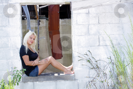 Beautiful Blonde at an Abandoned House (5) stock photo, A lovely young platinum blonde sits in the window of an abandoned, dilapidated house. by Carl Stewart