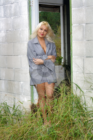 Beautiful Blonde in a Dilapidated House (2) stock photo, A lovely platinum-blonde stands in the doorway of an abandoned, dilapidated house. by Carl Stewart