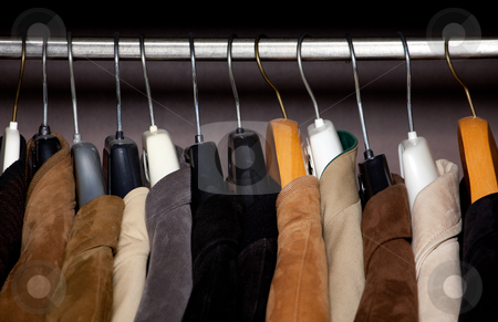 Wardrobe closeup horizontal shot stock photo, a closeup of some jackets on hangers in a wardrobe by Jerax