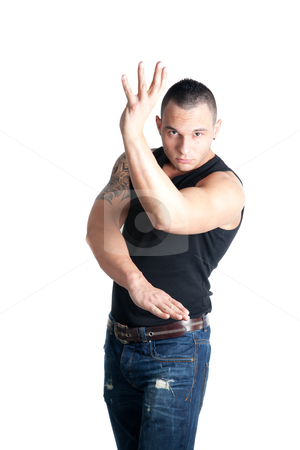 Young man stance stock photo, a casual dressed young man posing in a wing tsun stance by Jerax