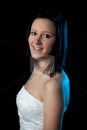Young woman portrait blue light stock photo, portrait of a young woman in a dress with blue backlight by Jerax