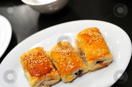 Vegetarian Oriental high tea stock photo, Freshly baked delicious pastry found in traditional Oriental high tea known as Dim Sum. by Wai Chung Tang