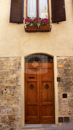 Ancient Door Windows Medieval Town San Gimignano Tuscany Italy stock photo, Ancient Door Windows Medieval Stone Town Bells San Gimignano Tuscany Italy by William Perry
