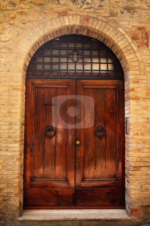 Ancient Brown Doorway Medieval Stone Town San Gimignano Tuscany  stock photo, Ancient Brown Doorway Medieval Stone Town San Gimignano Tuscany Italy by William Perry