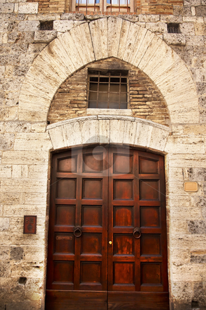 Ancient Brown Door Stone Doorway Medieval Town San Gimignano Tus stock photo, Ancient Brown Door Medieval Town Stone Doorway San Gimignano Tuscany Italy by William Perry