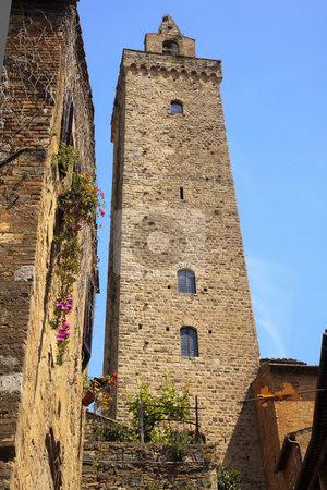 Stone Cuganensi Tower Medieval Town San Gimignano Tuscany Italy stock photo, Stone Cuganensi Tower Medieval Town Flowers San Gimignano Tuscany Italy by William Perry